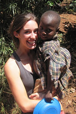 katie davis caring for child, uganda africa, mission
