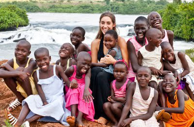 katie davis by river with adopted children