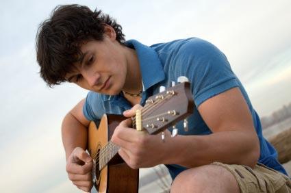 playing a guitar, practicing guitar