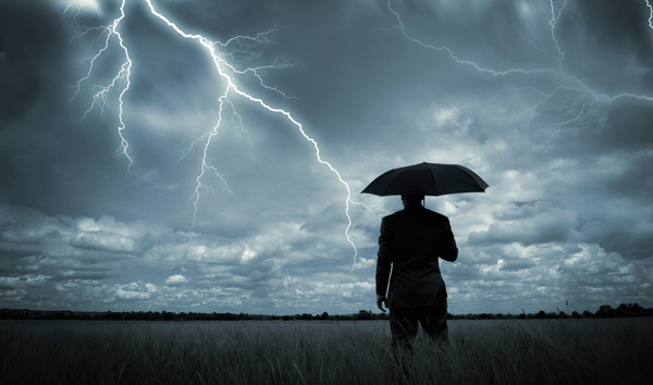 businessman in a storm, man with an umbrella