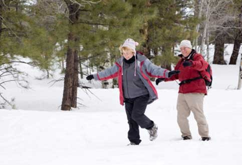 old couple in the snow, aging , healthy retirement, happy
