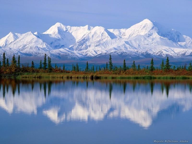majestic mountains, reflecting in lake